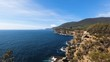 rugged coastline and cliffs next to the Tasman Arch and Devils Kitchen in the Tasman Peninsula in Tasmania