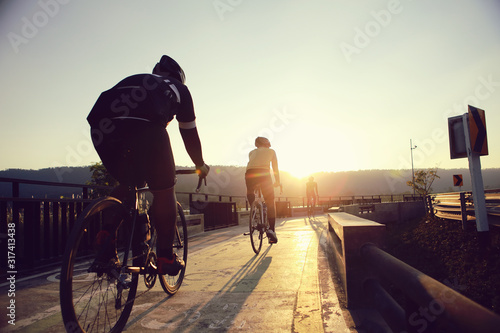 Obraz Cyclists are biking during the evening hours. - fototapety do salonu