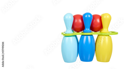 Fotografia, Obraz Plastic colored skittles for bowling game. Kids toy.