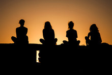 Silhouettes Of Girls At Sunset
