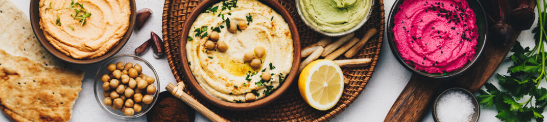 Flat-lay of Various Vegetarian dips hummus