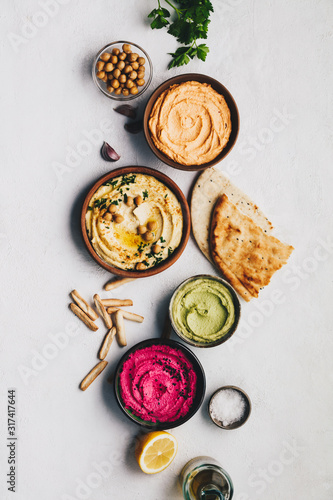Flat-lay of Various Vegetarian dips hummus