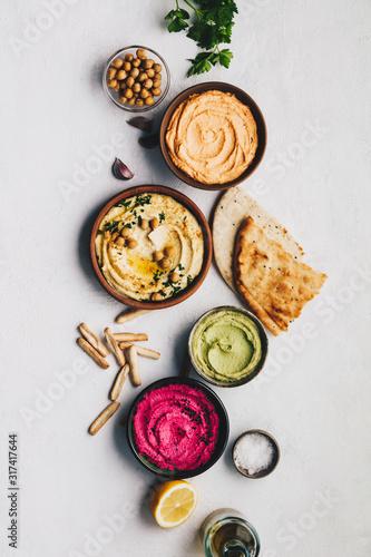 Foto Flat-lay of Various Vegetarian dips hummus