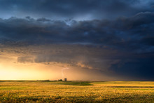 Stormy Sky Over A Farm Field At Sunset