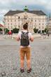 traveler man at tourist square at old european city