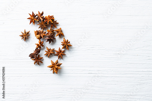 Fototapeta Top view of star anise on white text space. Organic spice concept. obraz
