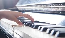 Caucasian Girl Playing Piano. Music