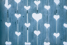 Hearts In A Wooden Fence. Rustic Background With Hearts Carved In Wood.