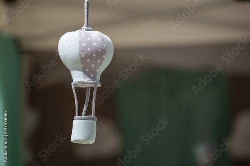 Closeup of a small knitted toy under the sunlight with a blurry background