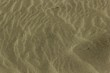 Closeup of sand in the beach under the sunlight - a nice picture for wallpapers and backgrounds
