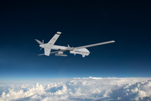 Military RC Military Drone Flies Flies Against Backdrop Of Beautiful Clouds On Blue Sky Background. Elements Of This Image Furnished By NASA