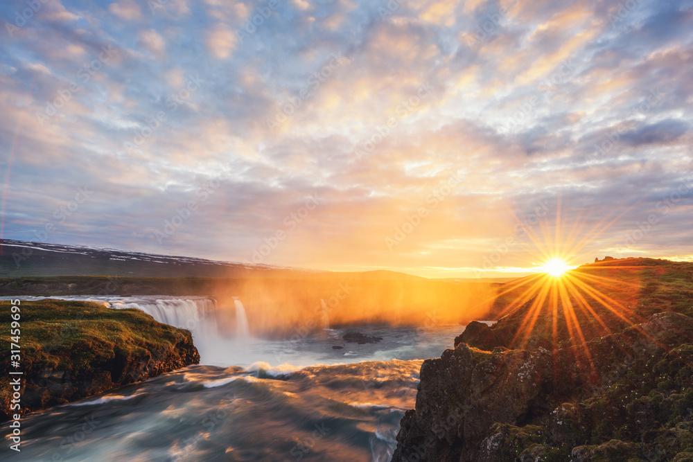 Colorful sunrise on Godafoss waterfall on Skjalfandafljot river, Iceland, Europe. Landscape photography
