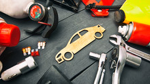 A Lot Of Different Car Accessories And Equipment On The Wooden Table