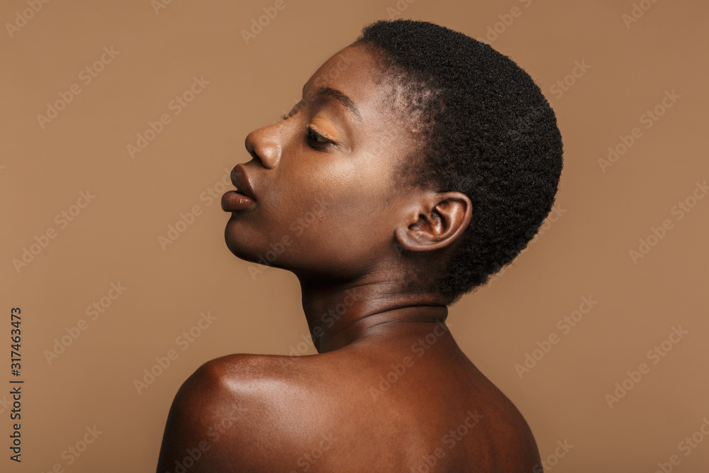 Fototapeta Beauty portrait of young half-naked african woman with short black hair
