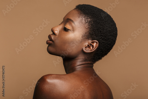 Obraz Beauty portrait of young half-naked african woman with short black hair - fototapety do salonu