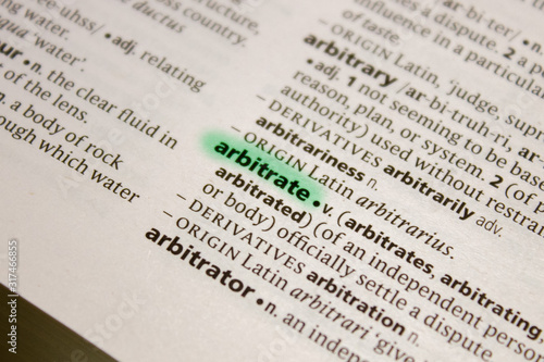 Photo Arbitrate word or phrase in a dictionary.