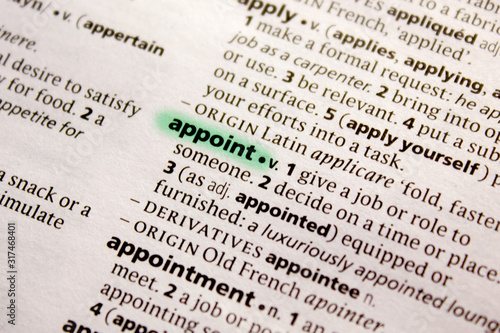 Photo Appoint word or phrase in a dictionary.