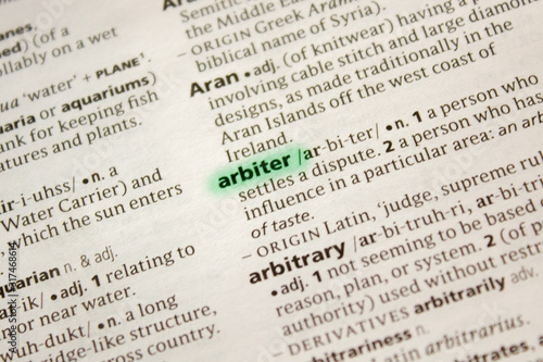 Photo Arbiter word or phrase in a dictionary.