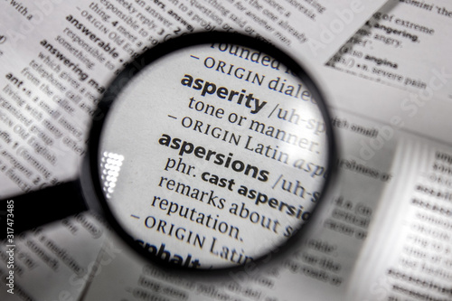 Photo The word or phrase aspersions in a dictionary.