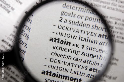 Photo The word or phrase attain in a dictionary.