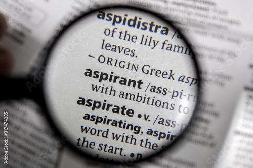 Photo The word or phrase aspirant in a dictionary.