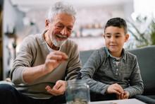 Grandpa And Grandson Saving Mo...