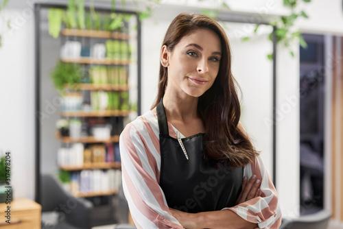 Smiling owner of hairdresser salon