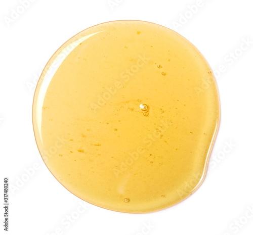 Fototapeta Honey drop isolated on white background, top view obraz