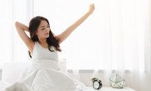 Woman Stretching Happy And Relaxed After Wake Up In The Morning At Home