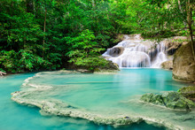 Waterfall In Tropical Forest A...
