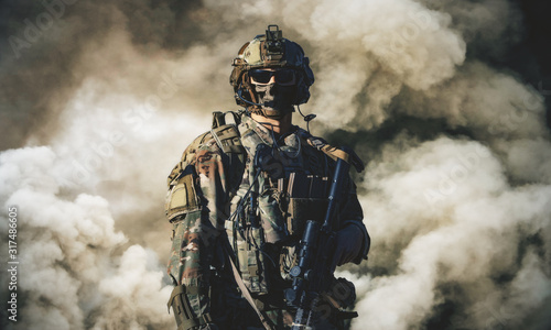 Swat force between smoke and gas in battle field Canvas Print