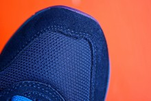 Part Of One Blue  Sneaker On A...