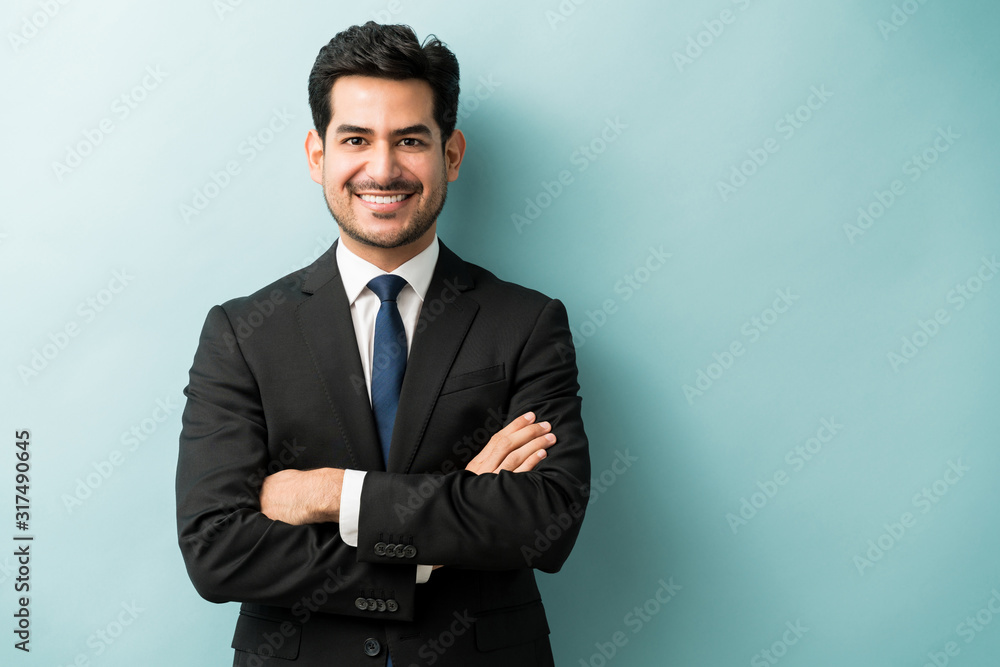 Fototapeta Handsome Hispanic Businessman In Black Suit