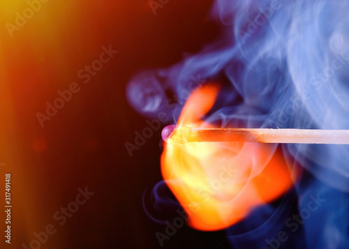 Burning match with blue smoke Wallpaper Mural