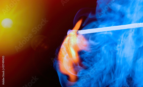 Burning match with blue smoke Canvas Print