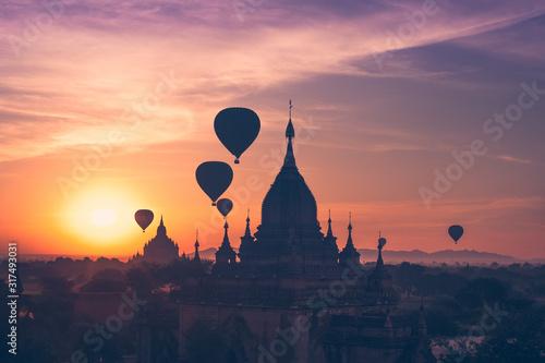 Hot air balloons flying over Buddhist Temples at Bagan. Myanmar Wallpaper Mural