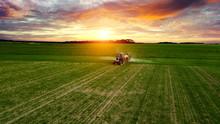 Farmer Working In The Field On...