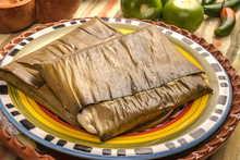 Tamales Oaxaqueños, Mexican Dish Made With Corn Dough, Chicken Or Pork And Chili, Wrapped In A Banana Leaves.