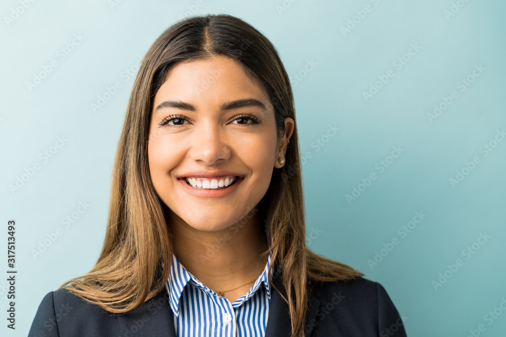 Fototapeta Pretty Hispanic Businesswoman Smiling In Studio