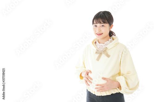 私服姿の若い妊婦の女性 Canvas Print