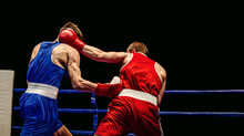 Boxing Match In Ring Boxers Exchange Of Blows