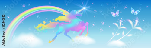 Fotomural Galloping iridescent unicorn with luxurious winding mane prancing against the ba