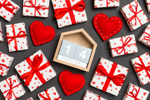 Composition Of Wooden Calendar, Holiday White Gift Boxes And Red Textile Hearts On Colorful Background. The Fourteenth Of February. Valentine's Day Concept