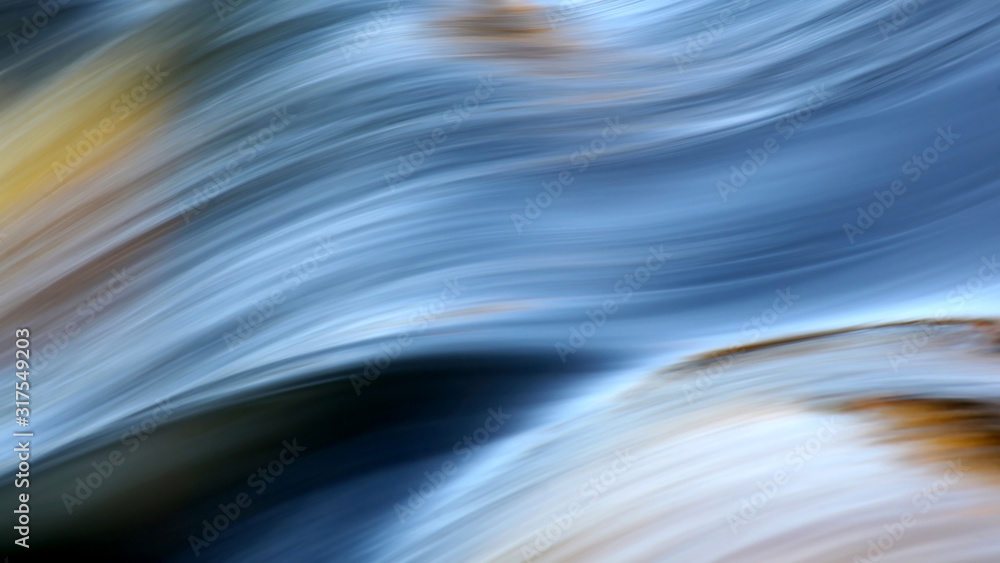 Fototapeta Flowing water with morning colors at the rapids of Vieremä, Forssa, Finland.
