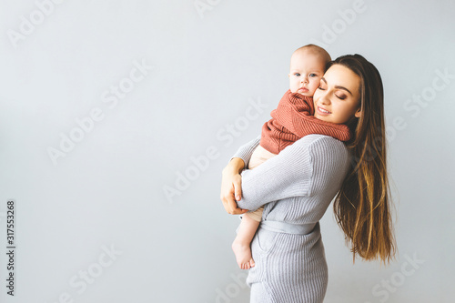 Happy mother holding up her baby girl Canvas Print
