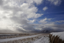 Hay Bales Near The Street Of Castelluccio After The Snow In A Winter Day, Sibillini Mountains, Norcia, Umbria, Italia