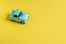 Toy Car On Yellow Background