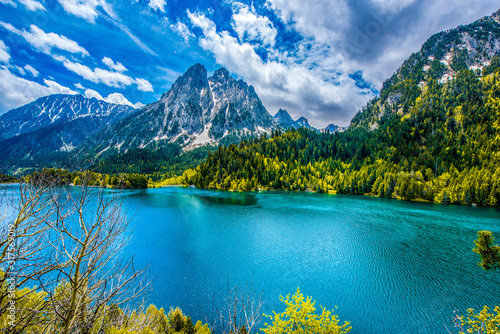 Alpine lake of San Mauricio in the Aigues Tortes National Park in the Spanish Pyrenees