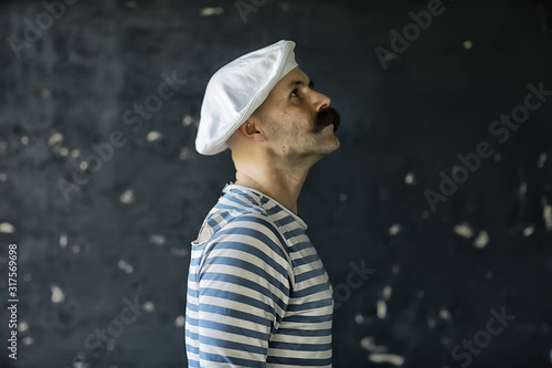 Fotografiet  brutal cook with mustache, unusual marine chef in a vest, vintage style