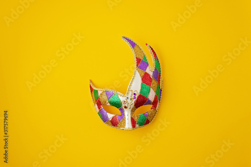 Leinwand Poster Festive, colorful mardi gras or carnivale mask and accessories over yellow background